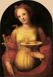 Sankta Lucia er ofte avbildet med øyne på et fat fordi en av legendene forteller at hun stakk ut øynene på seg selv for at en beiler ikke skulle beundre dem. («Saint Lucy» av Domenico di Pace Beccafumi, 1521 (fritt))